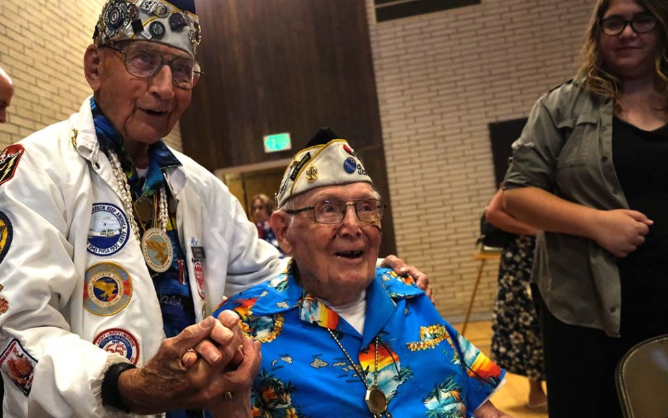 Pearl Harbor survivors Stu Hedley and Clayton Schenkelberg pose for photos.