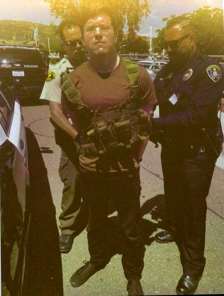 An evidence photo of the defendant being arrested was shown during the preliminary hearing.