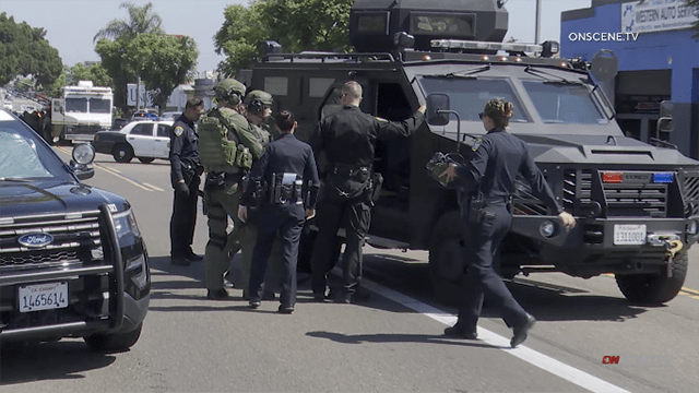 San Diego Police Department SWAT team and officers gather for City Heights activity.