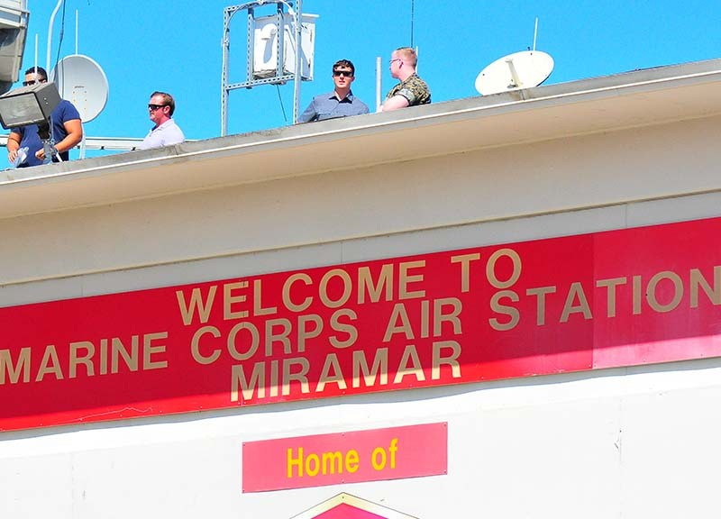 "Sign signals ""Welcome to Marine Corps Air Station Miramar."""