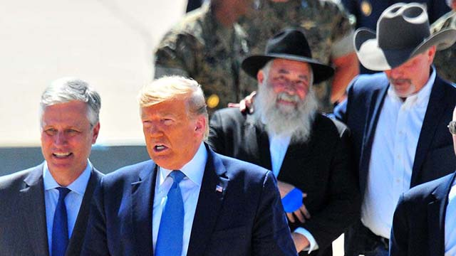 Chabad of Poway Rabbi Yisroel Goldstein and Poway Mayor Steve Vaus follow President Trump and his new national security adviser Robert O'Brien after welcome to Miramar Marine air station.