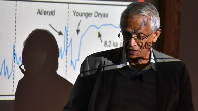 Veerabhadran Ramanathan shows charts demonstrating the dramatic effects of fossil fuels on the climate.