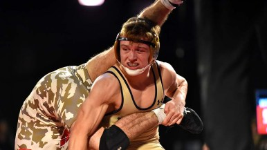 Navy junior Cody Trybus was bloodied in match against Tristan Moran in the Battle on the Midway.
