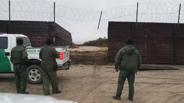 Breached section of border wall