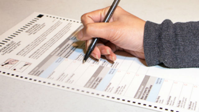 A voter fills out a California ballot