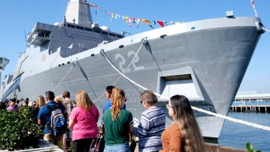 San Diegans stood in line to take a ship tour as part of Fleet Week at the Broadway Pier.