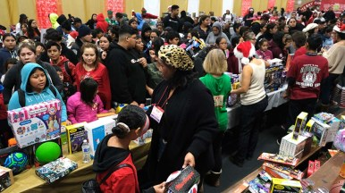 Thousands of parents and children combed through the tables of toys to find a favorite at Toys for Joy at Lincoln High School.