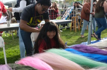 Girls had a chance to get dolled up as they had colorful strands braided into their hair.