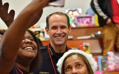 Volunteers take a selfie with San Diego Police Chief David Nisleit at Toys for Joy.
