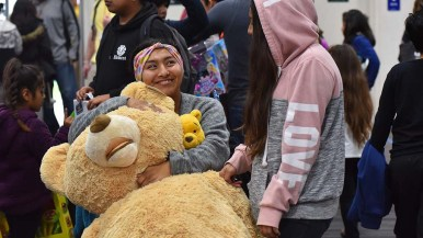 Vanessa Salazar of Logan Heights gladly hangs onto two stuffed bears her daughters picked out.
