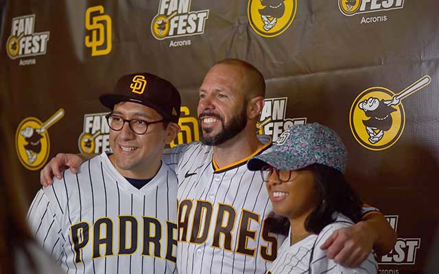 New manager Jayce Tingler posed for pictures with Josue Perez of La Jolla and Eva Fores of Vista at the annual FanFest at Petco Park.