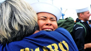 Abhan Toro is welcomed by family members at the homecoming of the USS Abraham Lincoln.