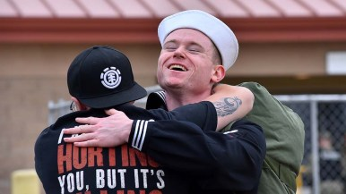 A sailor from the USS Abraham Lincoln is welcomed home by a loved one.