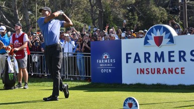 Tiger Woods hits off of Hole 1 on the north course of the Farmers Insurance Open on Thursday.