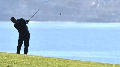 A Pro-Am player hits on the 4th hole of the south course at the Farmers Open Golf Tournament at Torrey Pines Golf Course in La Jolla.