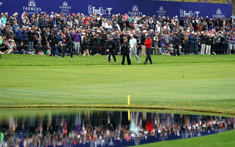 Golfers approach the 18th green on the south course of the Farmers Insurance Open at Torrey Pines Golf Course.