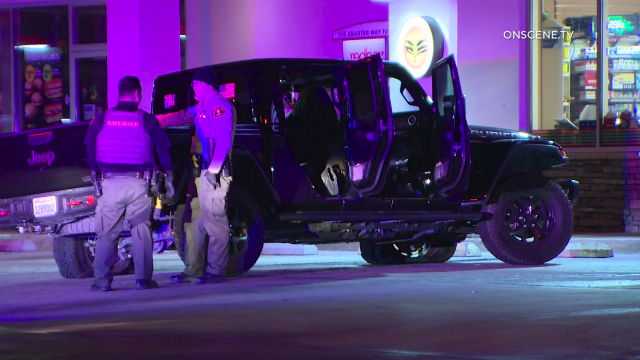 Deputies with the suspect's jeep