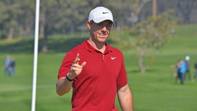 Rory McIlroy acknowledges the crowd's applause as he sunk one into the hole.