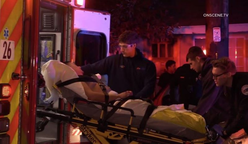 Paramedics assist wounded man