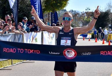Andreas Gustafsson signals victory in Olympic Trials 50K walk in Santee.