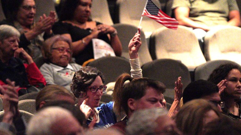 An audience member waved the flag during Valley Center congressional candidate forum.