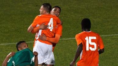 San Diego Loyal teammates celebrate a goal made by Jack Metcalf, No. 4.
