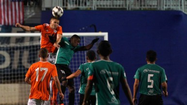 A San Diego Loyal player makes a header in the second half of the game.