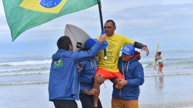 Alcino Neto from Brazil is carried by compatriots after winning the kneel surfing category in the Ampsurf 2020 ISA World Para Surfing Championship on La Shores Beach.