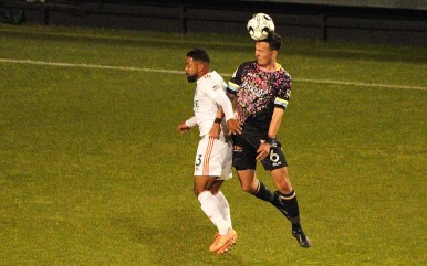 Mobi Fehr of the Las Vegas Nights (right) does a header during the second half of the match.