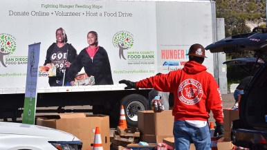 Local ironworkers helped distribute food collected by the San Diego Food Bank at SDCCU Stadium.