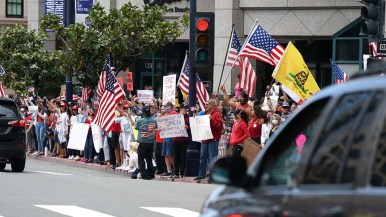 """Few at the """"freedom rally"""" observed six-foot social distancing rules."""