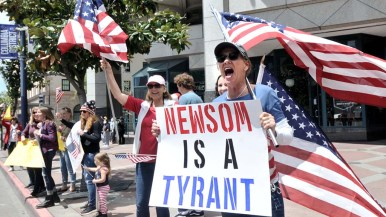 Protesters attacked the governor and stay-at-home restrictions.