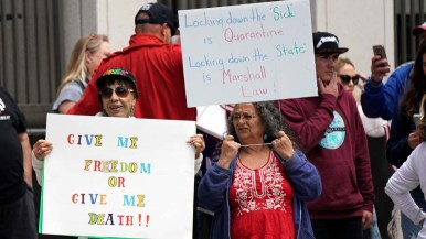 One woman's sign contrasted the lockdown of the sick with the lockdown of the state.
