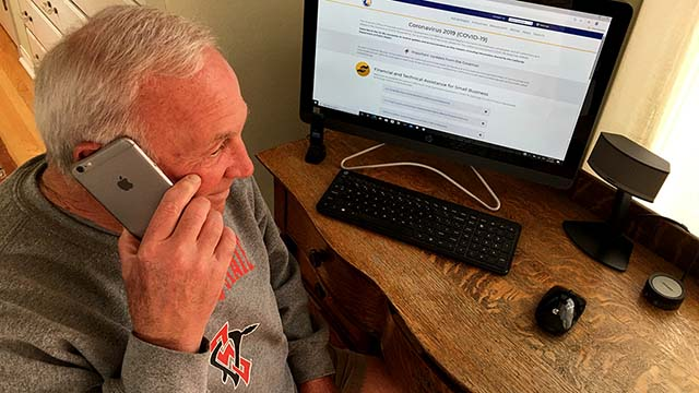 San Diego Regional Chamber of Commerce President and CEO Jerry Sanders keeps in touch via his iPhone and computer.
