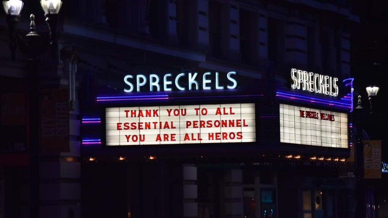 The downtown Spreckels Theater adds a message of support to essential workers.