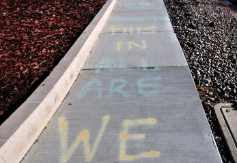 """""""We are in this together,"""" Lindsay Mitchell wrote to her neighbors on the Crawford Street sidewalk."""