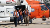 Acting Homeland Security Secretary Chad Wolf (far left) gets off Coast Guard helicopter while visiting San Diego to meet with U.S. Customs and Border Protection.