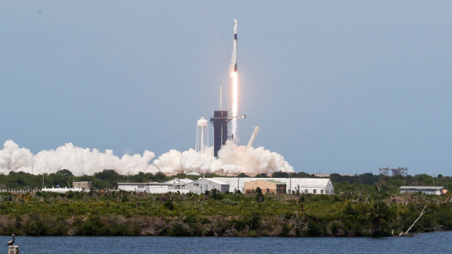 The Falcon 9 rocket with the Crew Dragon carrying two astronauts blasts off from Cape Canaveral
