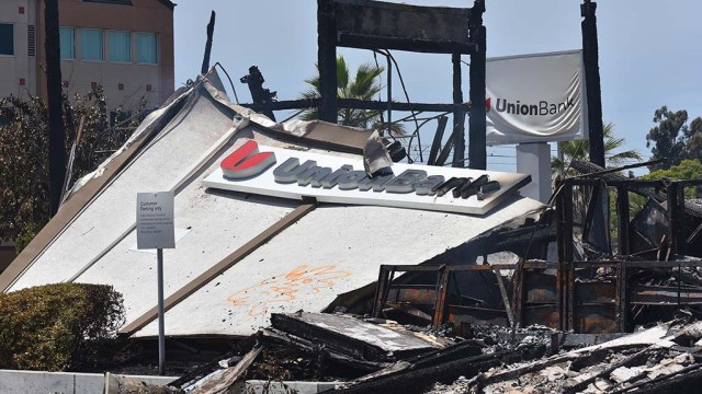A Union Bank lies in ruin after it was set ablaze the night before by arsonists and looters in downtown La Mesa.