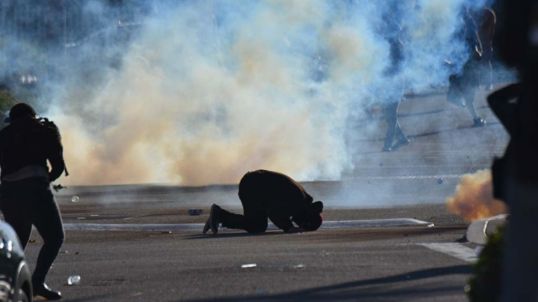 A protester shows effects of tear gas fired by La Mesa police.
