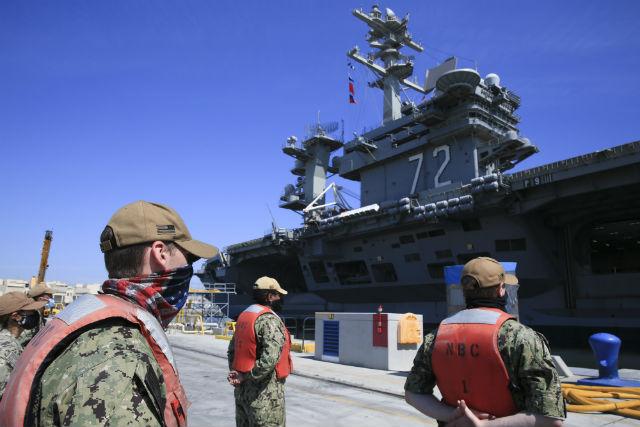 Sailors in face masks at North Island