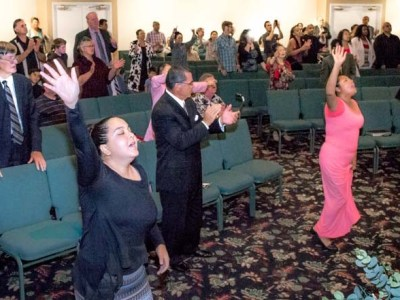 Congregants worship at South Bay Pentecostal Church in Chula Vista in June 2019 photo.