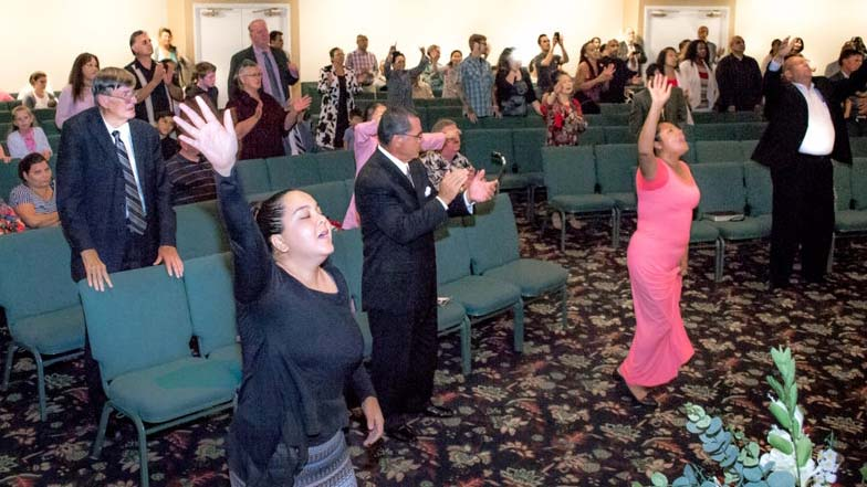 Congregants worship at South Bay Pentecostal Church in Chula Vista in June 2019 photo.