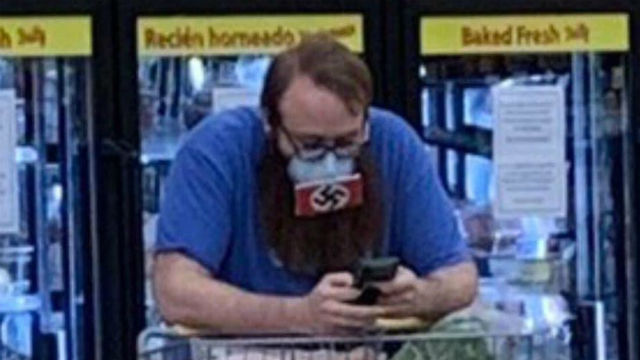 Image shared on Twitter of man wearing a swastika mask