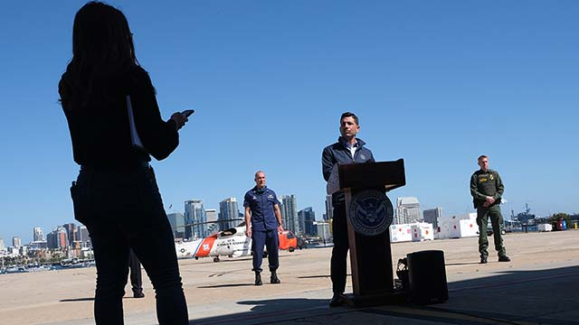 Acting Homeland Security Secretary Chad Wolf listens to a question during visit with reporters at the U.S. Coast Guard Station near Lindbergh Field.