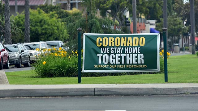 Coronado median signs encourage signals the city's support of Covid-19 guidelines.