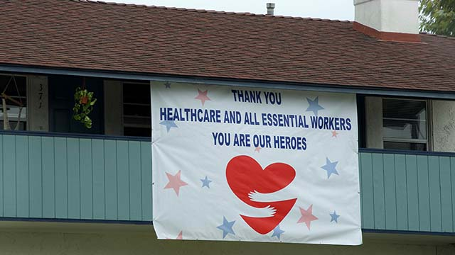 A sign at a Coronado residence supports healthcare and essential workers.