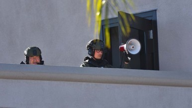 Police watch protesters from balcony outside La Mesa police chief's office