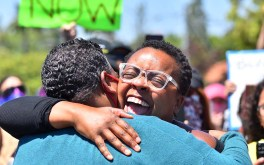 Organizer Tasha Williamson (left) and Christina Griffin-Jones embrace after Jones speaks to the crowd of about 400.