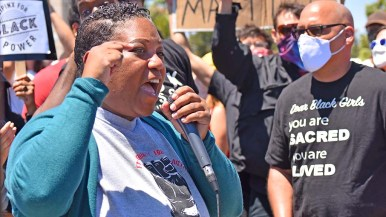 Organizer Tasha Williamson speaks to about 400 people at a protest at the La Mesa Police Department parking lot.